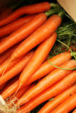 Organic carrots in a wooden box. Bio market concept, food background Royalty Free Stock Photo