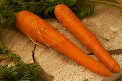 Organic carrots on a wooden surface, farm food,GMO free. royalty free stock photography