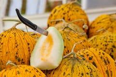 Organic Casaba Melon. Sliced with a knife at a Turkish street market stock photo