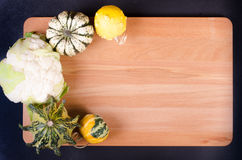 Organic cauliflower and decor pumpkins on wooden background Stock Photo