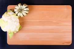 Organic cauliflower and pumpkin on wooden background Royalty Free Stock Photo