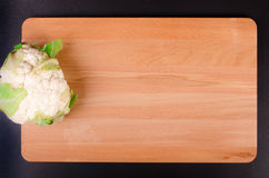Organic  cauliflower on wooden background Royalty Free Stock Images