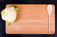 Organic  cauliflower on wooden background with spoon Stock Photo