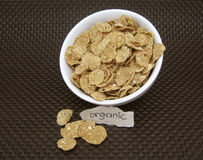 Organic Cereal. Cereal in a white bowl on a brown background Stock Image