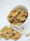 Organic Cereal. Cereal in a white bowl on a white background Stock Photos
