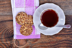 Organic cereal biscuits on a plate and tea Stock Image