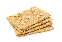 Organic cheese crackers with sunflower seeds. Organic cheese crackers with sesame and sunflower seeds. Isolated on white background stock photo