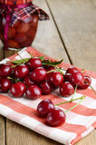 Organic Cherries on the checkered napkin Stock Images