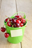 Organic Cherries in the green bucket Royalty Free Stock Photos
