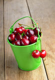 Organic Cherries in the green bucket Royalty Free Stock Image
