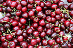 Organic cherries in a pile. Bio market concept, food background Stock Image