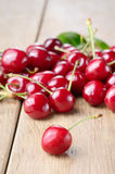 Organic Cherries on the wooden table Stock Photo