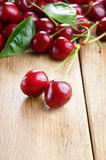 Organic Cherries on the wooden table Stock Images