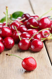 Organic Cherries on the wooden table Stock Image