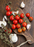 Organic cherry tomatoes with garlic and thyme Stock Photo