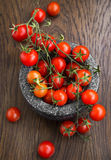 Organic cherry tomatoes in a marble mortar Stock Photos