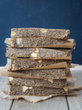 Organic chewy muesli granola power bars. Homemade organic healthy chewy muesli granola power bars with wholemeal oats, cashew butter, honey and nuts, arranged in royalty free stock images