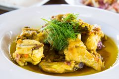Organic chicken adobo in turmeric ginger Royalty Free Stock Images