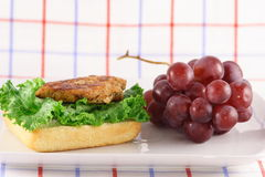 Organic chicken breast sandwich. Organic chicken breast  a perfect protein source with fine italian bread fruits and vegetables Stock Photo