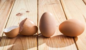 Organic chicken eggs and eggshell. On a wooden texture background Stock Images
