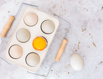 Organic chicken eggs. Farm fresh free range  chicken eggs in vintage holder on rustic background. Top view, blank space, vintage toned image Royalty Free Stock Image