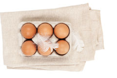 Organic chicken eggs. Organic chicken eggs in paper box on white background, top view Royalty Free Stock Images