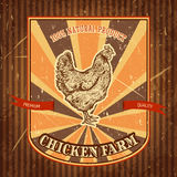 Organic chicken farm vintage label with chicken on the grunge background. Stock Photo