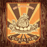 Organic chicken farm vintage label with hen with chicks on the grunge background. Retro hand drawn vector illustration poster in sketch style Stock Photo