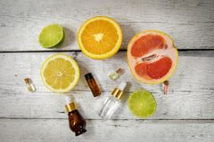 Organic citrus essential oils and cosmetics. Top view royalty free stock photos