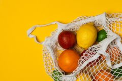 Organic citrus fruits variety in cotton mesh reusable shopping bag - recycling, sustainable lifestyle, zero waste, no plastic. Organic citrus fruits variety in stock image
