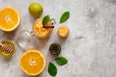Organic citrus scrub homemade on gray background top view royalty free stock photo