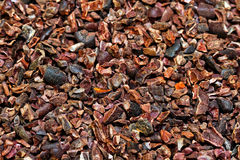 Organic cocoa nibs. Bunch of raw organic crushed cocoa nibs stock images
