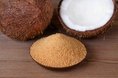 Organic coconut sugar, healthy alternative. Wooden background stock photo