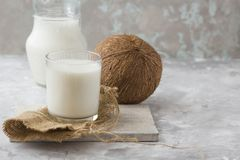 Organic coconut yogurt in wooden bowl dairy free yogurt probiotic food stock images