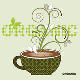 Organic coffee. Coffee cup with steam and leaves word organic Royalty Free Stock Image