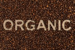 Organic coffee written on roasted beans Stock Image