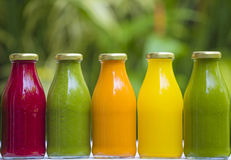 Organic cold-pressed raw vegetable juices. In glass bottles Royalty Free Stock Images
