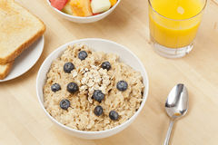 Organic Cooked oatmeal with blueberries Stock Photo