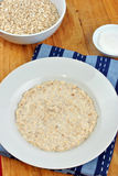 organic cooked porridge on a plate Royalty Free Stock Photos