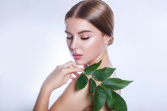 Organic cosmetic . Beautiful woman face portrait with green leaf , concept for skin care or organic cosmetics stock photography