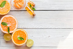 Organic cosmetic with citrus on wooden background top view Stock Image
