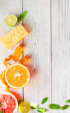 Organic cosmetic with citrus on wooden background top view Stock Photography