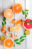 Organic cosmetic with citrus on wooden background top view Royalty Free Stock Photography