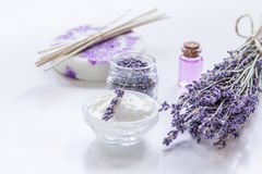 Organic cosmetic with lavender flowers and oil on white background Royalty Free Stock Photography