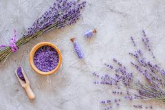 Cosmetic set with lavender herbs and sea salt in bottle on stone table background flat lay Royalty Free Stock Photography