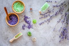 Cosmetic set with lavender herbs and sea salt in bottle on stone table background flat lay Royalty Free Stock Photo