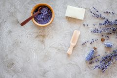Cosmetic set with lavender herbs and sea salt in bottle on stone table background flat lay mockup Royalty Free Stock Photos