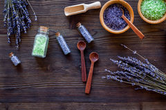 Cosmetic set with lavender herbs and sea salt in bottle on wooden table background flat lay Stock Photography