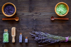 Cosmetic set with lavender herbs and sea salt in bottle on wooden table background flat lay mockup Stock Photo