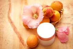 Organic cosmetics based on fruit and flower extracts Stock Photography